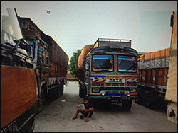 Deepak Yadav, an Indian transport worker waiting among the trucks parked near the India/Nepal border.